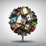 Real Estate Agent Concept. Real estate agent or realtor concept as a power seller sales person lifting a group of residential homes as a housing market and Royalty Free Stock Photo