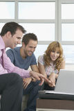 Real Estate Agent And Couple With Laptop In New Home Royalty Free Stock Photos