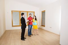 Real Estate Agent with couple. Real Estate Agent with young couple in new house Royalty Free Stock Photography