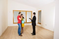 Real Estate Agent with couple Stock Image