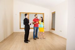 Real Estate Agent with couple Stock Photos