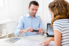 Real estate agent and customer at the office Stock Photography