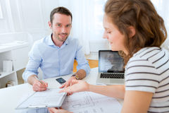Real estate agent and customer at the office Stock Images
