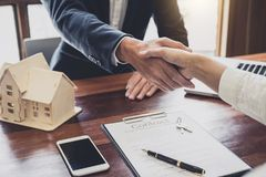 Real estate agent and customers shaking hands together celebrati royalty free stock photo