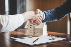 Real estate agent and customers shaking hands together celebrating finished contract after about home insurance and investment lo stock photos