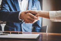 Real estate agent and customers shaking hands together celebrating finished contract after about home insurance and investment lo. An, handshake and successful royalty free stock photo