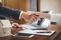 Real estate agent and customers shaking hands together celebrating finished contract after about home insurance and investment lo. An, handshake and successful stock photos