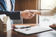 Real estate agent and customers shaking hands together celebrating finished contract after about home insurance and investment lo. An, handshake and successful stock photo