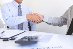 Real estate agent and customers shaking hands together celebrating finished contract after about home insurance and investment royalty free stock photography