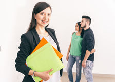 Real estate agent with customers stock photography