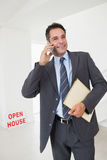 Real estate agent with documents using mobile phone Royalty Free Stock Photos