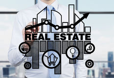 Real estate agent is drawing the chart of the real estate market on the glass screen. Real estate agent is drawing the chart of the real estate market on the Royalty Free Stock Image