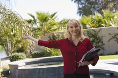 Real Estate Agent Gesturing Stock Photo