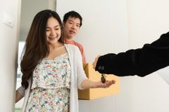 Real estate agent give house key to couple. Real estate agent give house key to Asian happy couple owner at front door. Family life to start. buy or purchase royalty free stock photography