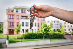 Real estate agent giving flat keys to a new property owner Stock Image