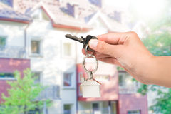 Real estate agent giving house key. Royalty Free Stock Photo