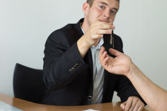 Real Estate Agent Giving House Key to Buyer Stock Image
