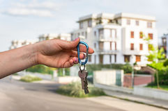 Real estate agent giving house keys to a new property owner Royalty Free Stock Photography
