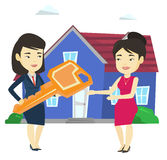 Real estate agent giving key to new house owner. Royalty Free Stock Images