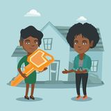 Real estate agent giving key to a new house owner. Young african real estate agent giving key to a new house owner. Real estate agent passing house key to a Stock Photos