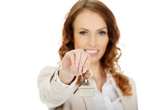 Real estate agent giving keys. Royalty Free Stock Image