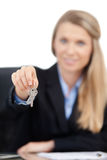 Real estate agent giving keys. Focus on the keys. A real estate agent giving you keys to your new home. Isolated on white background Stock Images