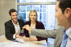 Real-estate agent giving keys to new property owne Stock Photo