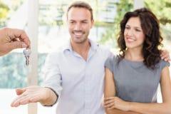 Real-estate agent giving keys Stock Images