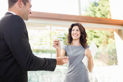 Real-estate agent giving keys Royalty Free Stock Images