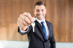Real-estate agent giving keys. To new property owners Royalty Free Stock Image