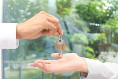 Real estate agent giving keys to woman royalty free stock images