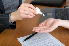 Real estate agent Hand over house key royalty free stock photo