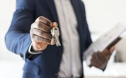Real estate agent handing the house key Stock Photos