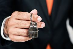 Real Estate Agent Handing over an house key. New concept House royalty free stock photos