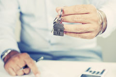Real estate agent. Handing over house keys royalty free stock photo