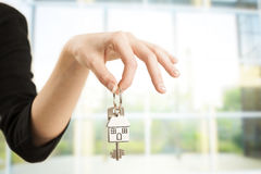 Real estate agent. Handing over house keys royalty free stock photos
