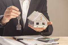 Real estate agent handing over house keys. Royalty Free Stock Photography