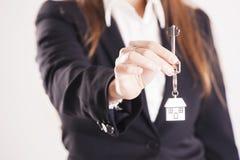 Real estate agent handing over house keys Stock Photos
