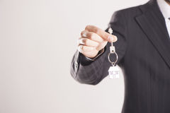 Real estate agent handing over house keys Royalty Free Stock Photos