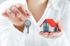 Real estate agent handing over keys to home. Real estate woman agent handing over keys to home Stock Images