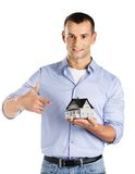 Real estate agent hands model house. Real estate agent hands small model house, isolated on white Stock Image
