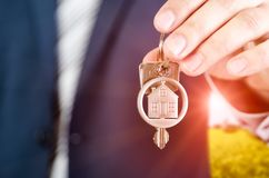 Real estate agent holding key of new apartment close up. Realestate key real estate house security home deal concept stock photos