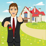 Real estate agent holding the key of a new house Royalty Free Stock Images