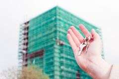 A real estate agent holding keys to a new apartment in her hands. Stock Photography
