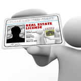 Real Estate Agent Holding License Laminated Identification Card. A real estate agent holds a laminated license proving he is certified and licensed by the proper vector illustration