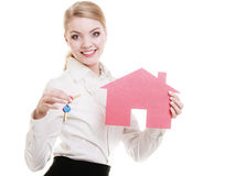 Real estate agent holding red paper house keys Royalty Free Stock Photography