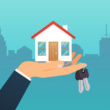 Real estate agent holds the key from the home. Offer of purchase Stock Photography