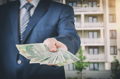 Real estate agent holds Polish money Stock Photos
