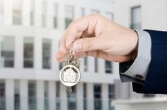 Real estate agent with home keys. Realestate key apartment real estate home homeowner starts concept royalty free stock image