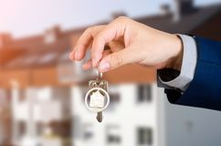 Real estate agent with home keys. Realestate key apartment real estate home homeowner starts concept stock photography
